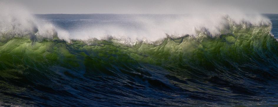 Waves crash along the backshore in Gloucester, MA