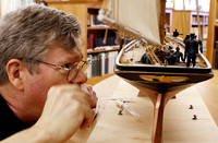 Eric Ronnberg Inspects the Model Yacht America